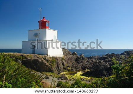 historic Amphitrite Lighthouse in Ucluelet, Vancouver Island, part of the Wild Pacific Trail - stock photo
