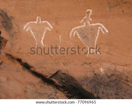 Historic Anasazi Pictograms: white figures on sandstone surface in Grand Gulch, Utah, USA. - stock photo