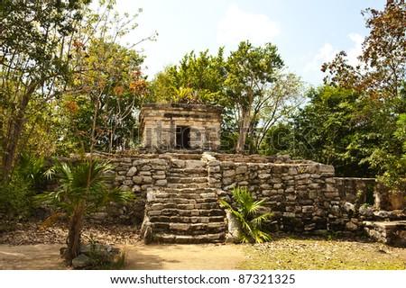 Historic ancient Mayan ruins in Mexico at XCaret park. - stock photo