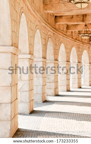 Historic and beautiful walkway with arches - stock photo