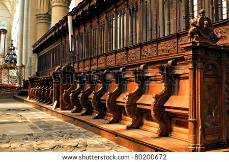 historic and monumental church bench from  1540 in the cathedral of dordrecht in the  netherlands