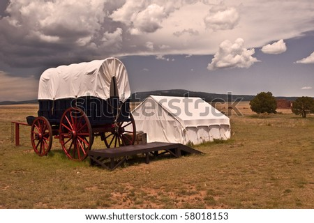 Historic Army Conestoga Wagon and Tent at Fort Union National Historic Park in Northern New Mexico - stock photo