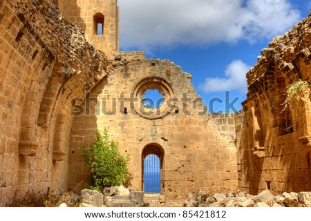 Historic Bellapais Abbey in Kyrenia, Northern Cyprus. Original construction was built between 1198-1205, it is the most beautiful Gothic building in the Near East. - stock photo