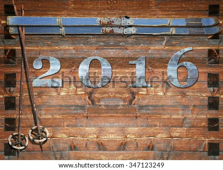 Historic blue coated ski  with poles and 2016 date letters fixed on a wooden board - stock photo