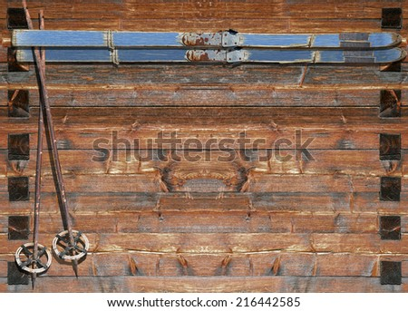 Historic blue coated ski  with poles fixed on a wooden board - stock photo