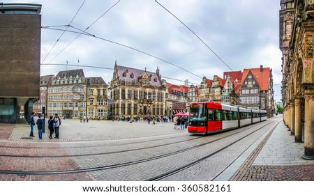 Historic Bremen Market Square in the centre of the Hanseatic City of Bremen with view on famous Raths-Buildings, town hall and tramway, Germany - stock photo