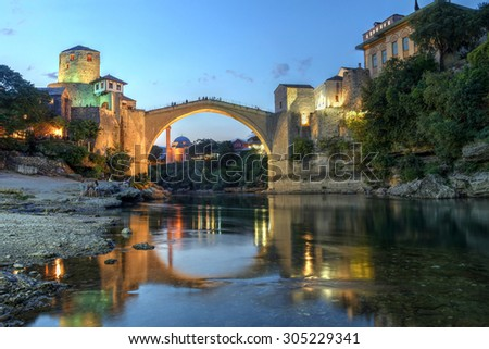 Historic bridge over the Neretva river in Mostar, Bosnia Herzegovina at twilight.