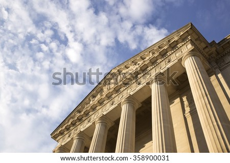 Historic building in Washington DC over bright blue sky. Place for copy