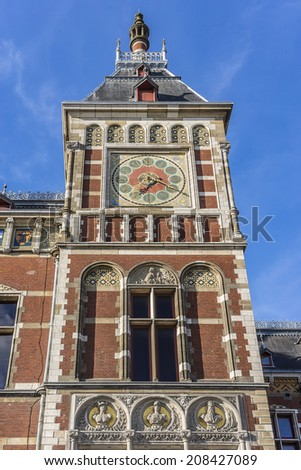 Historic building of Amsterdam central railway station (Amsterdam Centraal), Netherlands. Amsterdam Centraal's building was designed by Pierre Cuypers and A. L. van Gendt, first opened in 1889. - stock photo
