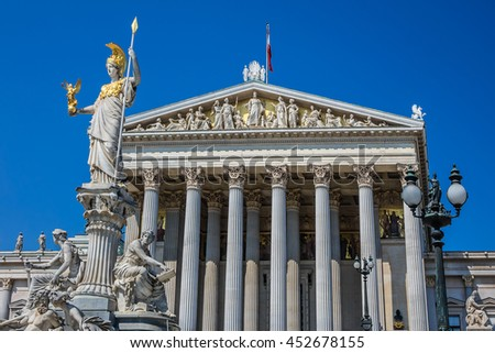 Historic building of the Austrian Parliament (architect Theophil Hansen, 1874 - 1883). Architectural fragments of the main portal. Vienna, Austria. - stock photo