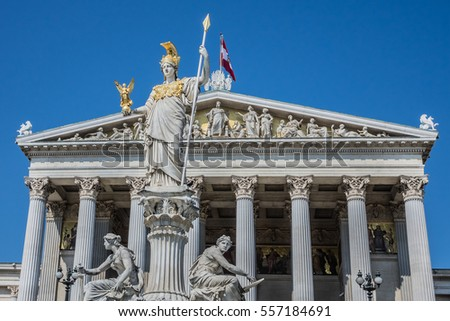 Historic building of the Austrian Parliament (architect Theophil Hansen, 1874 - 1883). Architectural fragments of the main portal. Vienna, Austria.