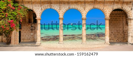 Historic building with arches and flowers - stock photo
