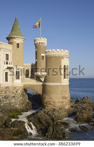 Historic building (Wulff Castle) built on the rocky Pacific coast of central Chile at Vina del Mar. - stock photo