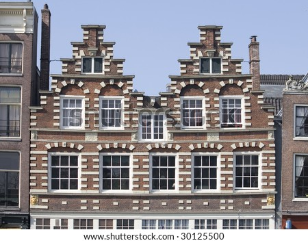 Historic buildings in Amsterdam - stock photo