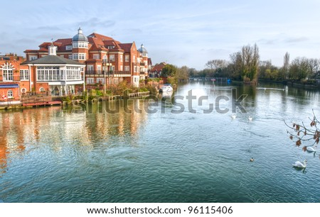 Historic buildings of old Windsor in the early morning light,, looking downstream over the Thames. - stock photo