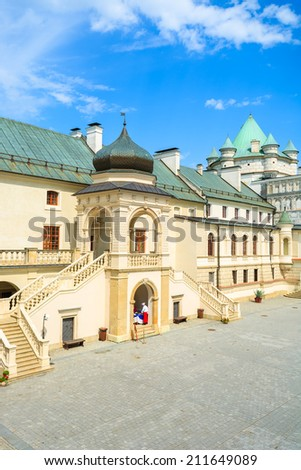 Historic buildings on courtyard of Krasiczyn castle on sunny summer day, Poland - stock photo
