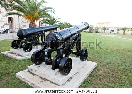 Historic canons on display at a Bermuda fort. - stock photo