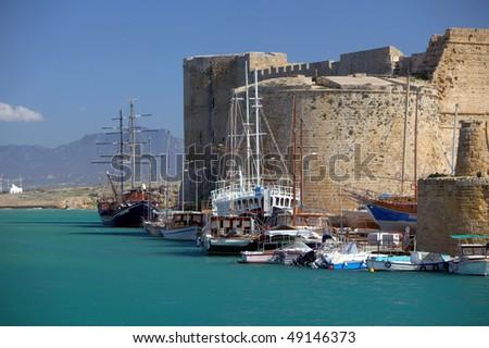 Historic castle and harbour in Kyrenia - stock photo