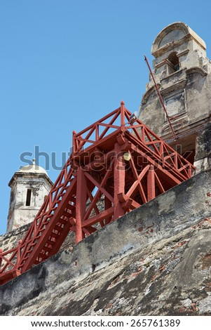 Historic castle of San Felipe De Barajas on a hill overlooking the Spanish colonial city of Cartagena de Indias on the coast of Colombia. - stock photo