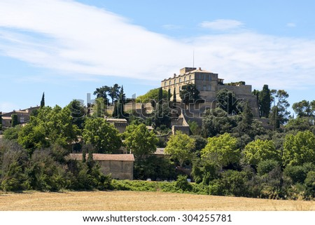 Historic castle on the hill, the Chateau and the village of Ansouis is a tourist attraction in the southern region of Provence, region Luberon, France. - stock photo