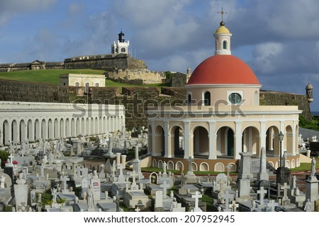 Historic cemetery and Puerto Rican flag at Castillo San Felipe del Morro, a 16th-century fortress located in San Juan, Puerto Rico, designated as UNESCO World Heritage Site in 1983. - stock photo