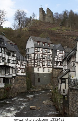 Historic center of Monschau at the Rur river. Above the city is the castle Monschau, which dates back to the 13th century.