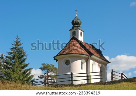 historic chapel in the alps, with onion dome. - stock photo