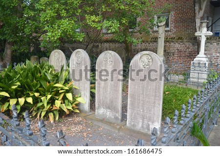 Historic Charleston graveyard headstones - stock photo
