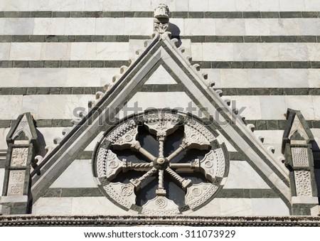 historic church stone rose in pistoia tuscany - stock photo