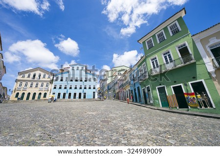 Historic city center of Pelourinho Salvador, Brazil features colorful colonial architecture on a broad cobblestone hill - stock photo