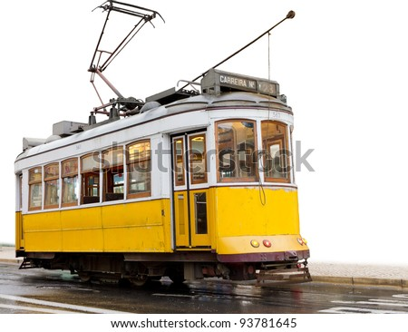 historic classic yellow tram of Lisbon built partially isolated on white, Portugal - stock photo