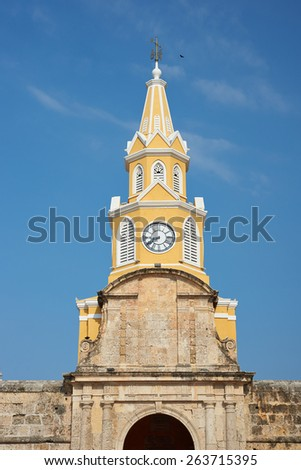 Historic Clock Tower (Torre del Reloj) above the main gateway into the historic walled city of Cartagena de Indias in Colombia - stock photo