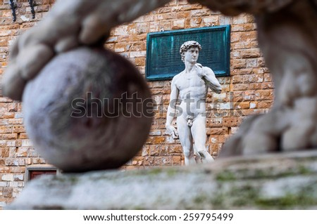 historic David statue by Michelangelo in front of Palazzo Vecchio in Florence, Italy. - stock photo