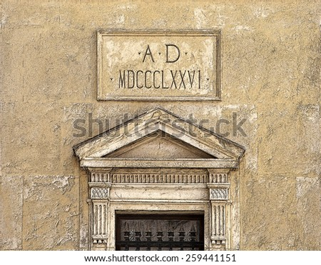 Historic doorway on stone building with the date in Roman numerals - stock photo
