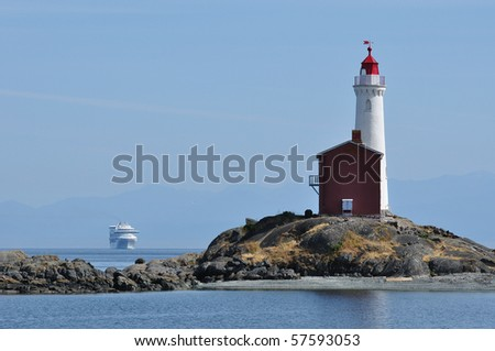Historic fisgard lighthouse at seashore, it is the first lighthouse built in vancouver island in 1860, victoria, british columbia, canada - stock photo
