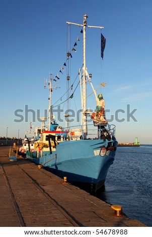 Historic fishing boat in port - stock photo