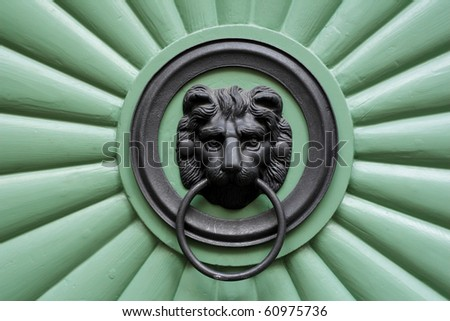 Historic green door with ornament lion in Prague, Czech republic