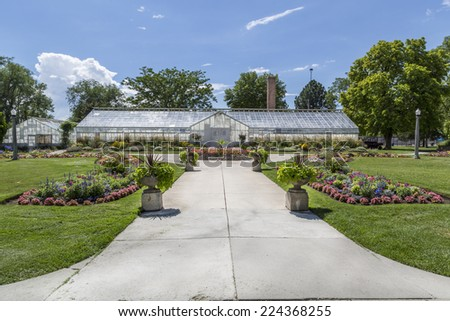 Historic greenhouse at the public Liberty Park in Salt Lake City, Utah. - stock photo