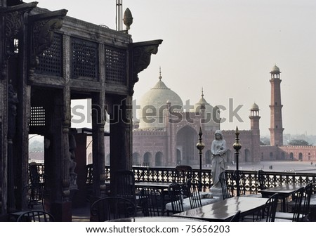 Historic haveli and rooftops of the Badshahi Mosque, Lahore - stock photo