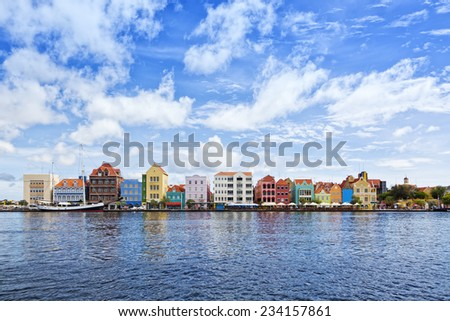 Historic houses with colorful facades at waterfront of Willemstad, Curacao - stock photo