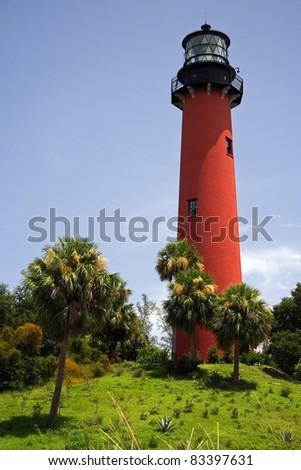 Historic Jupiter Lighthouse atop an ancient Indian shell mound, Jupiter Inlet, Florida - stock photo