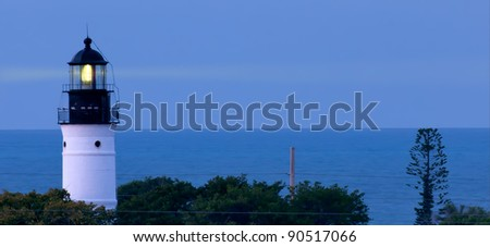historic key west florida lighthouse shines before dawn - stock photo