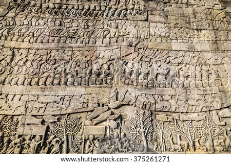 Historic Khmer bas-relief showing Hindu legend scenes at Bayon temple, Cambodia. - stock photo