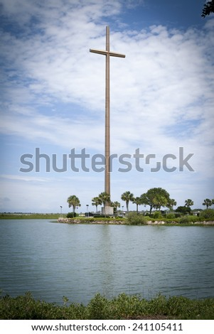 Historic large cross against a cloudy Florida sky, St Augustine - stock photo