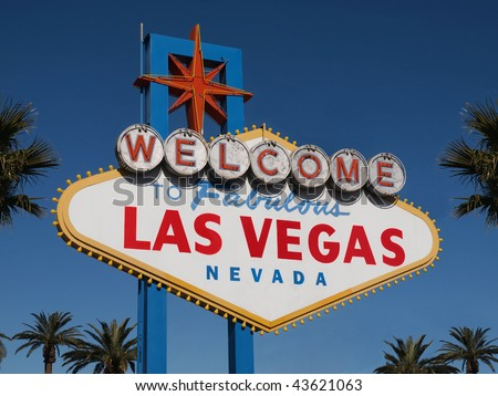 Historic Las Vegas Welcome sign with Palm Trees. - stock photo