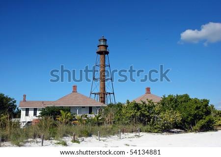 historic lighthouse at midday Sanibel Island Florida - stock photo