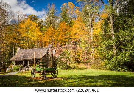 Historic lumber mill cabin and wagon in mountains of NC - stock photo
