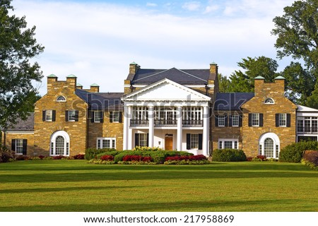 Historic Mansion at Civic Center Park in Rockville, Maryland. Glenview mansion with formal gardens at sunset. - stock photo