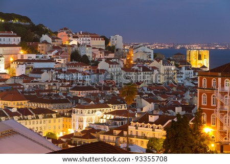 historic mediterranean architecture with church at night with light in Lisboa, Portugal - stock photo