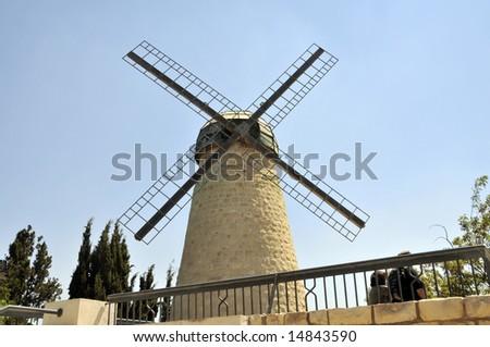 Historic Montefiori windmill against a  blue sky in Yemin Moshe neighborhood of Jerusalem - stock photo